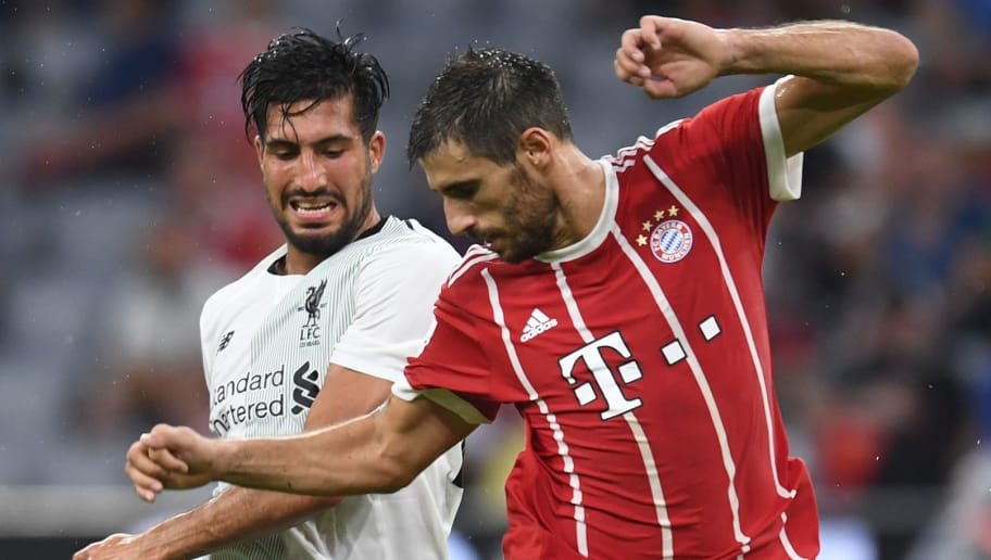 Liverpool's German midfielder Emre Can (L) and Bayern Munich's Spanish midfielder Javi Martinez (R) vie for the ball during the second Audi Cup football match between FC Bayern Munich and FC Liverpool in the stadium in Munich, southern Germany, on August 1, 2017.  / AFP PHOTO / Christof STACHE        (Photo credit should read CHRISTOF STACHE/AFP/Getty Images)