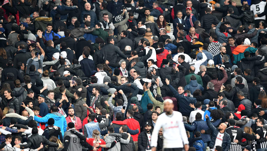 Besiktas supporters react during the second leg of the last 16 UEFA Champions League football match between Besiktas and Bayern Munich at Besiktas Park in Istanbul on March 14, 2018.  / AFP PHOTO / Bulent Kilic        (Photo credit should read BULENT KILIC/AFP/Getty Images)