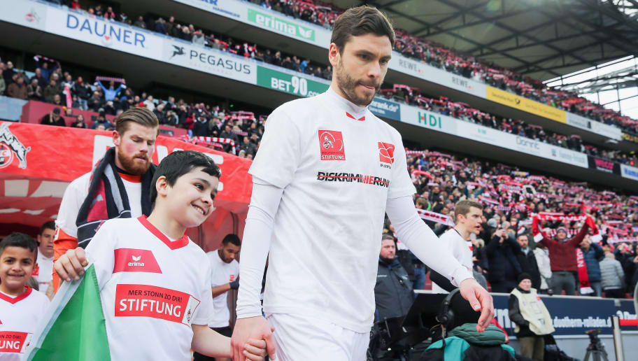COLOGNE, GERMANY - MARCH 18: Jonas Hector  of Koeln walks in wearing a shirt with a message against discrimination for the campaign 'Say No to prejudice', an anti-discrimination campaign of the DFL foundation, prior to the Bundesliga match between 1. FC Koeln and Bayer 04 Leverkusen at RheinEnergieStadion on March 18, 2018 in Cologne, Germany.  (Photo by Alex Grimm/Bongarts/Getty Images)