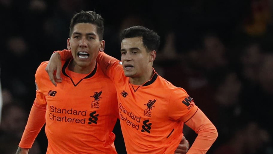 Liverpool's Brazilian midfielder Roberto Firmino (L) celebrates scoring  the team's third goal with Liverpool's Brazilian midfielder Philippe Coutinho during the English Premier League football match between Arsenal and Liverpool at the Emirates Stadium in London on December 22, 2017.  / AFP PHOTO / Adrian DENNIS / RESTRICTED TO EDITORIAL USE. No use with unauthorized audio, video, data, fixture lists, club/league logos or 'live' services. Online in-match use limited to 75 images, no video emulation. No use in betting, games or single club/league/player publications.  /         (Photo credit should read ADRIAN DENNIS/AFP/Getty Images)