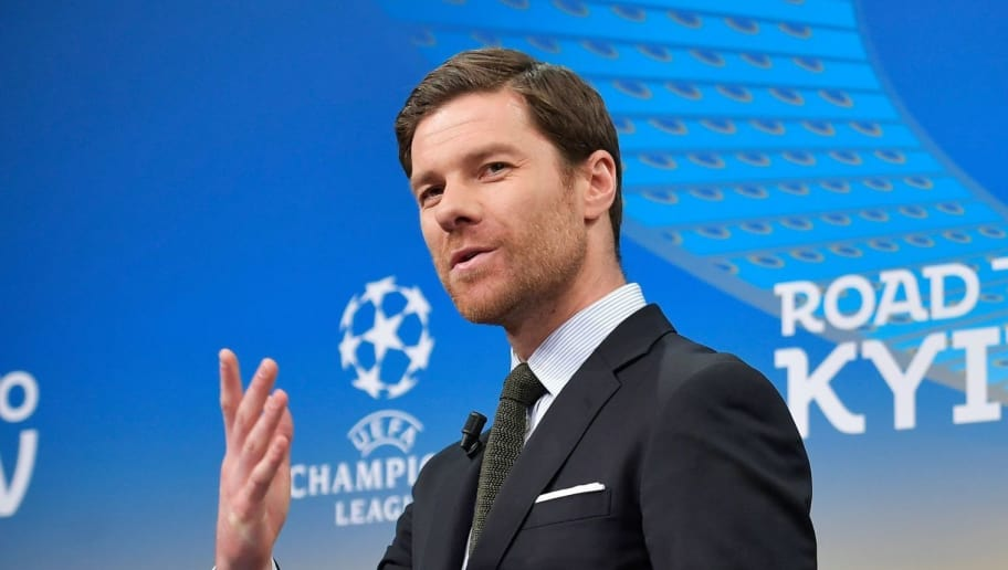 Spanish former international Xabi Alonso speaks next to the Champions League trophy ahead of the draw for the round of 16 of the UEFA Champions League football tournament at the UEFA headquarters in Nyon on December 11, 2017. / AFP PHOTO / Fabrice COFFRINI        (Photo credit should read FABRICE COFFRINI/AFP/Getty Images)