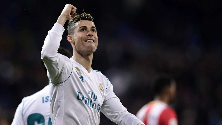TOPSHOT - Real Madrid's Portuguese forward Cristiano Ronaldo celebrates his fourth goal during the Spanish League football match between Real Madrid CF and Girona FC at the Santiago Bernabeu stadium in Madrid on March 18, 2018. / AFP PHOTO / JAVIER SORIANO        (Photo credit should read JAVIER SORIANO/AFP/Getty Images)