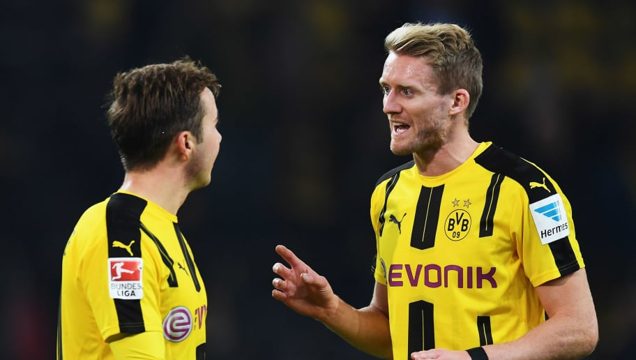 DORTMUND, GERMANY - OCTOBER 29:  André Schürrle makes a point to Mario Götze of Dortmund during the Bundesliga match between Borussia Dortmund and FC Schalke 04 at Signal Iduna Park on October 29, 2016 in Dortmund, Germany.  (Photo by Stuart Franklin/Bongarts/Getty Images)
