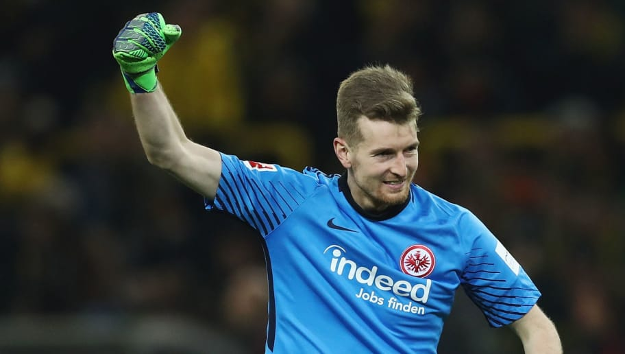 DORTMUND, GERMANY - MARCH 11: Goalkeeper Lukas Hradecky of Frankfurt reacts after team mate Luka Jovic scored their team's first goal during the Bundesliga match between Borussia Dortmund and Eintracht Frankfurt at Signal Iduna Park on March 11, 2018 in Dortmund, Germany.  (Photo by Lars Baron/Bongarts/Getty Images)