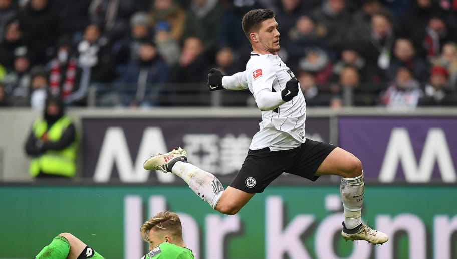 FRANKFURT AM MAIN, GERMANY - MARCH 17: Luka Jovic of Frankfurt (top) runs over goalkeeper Florian Mueller of Mainz during the Bundesliga match between Eintracht Frankfurt and 1. FSV Mainz 05 at Commerzbank-Arena on March 17, 2018 in Frankfurt am Main, Germany. (Photo by Matthias Hangst/Bongarts/Getty Images)