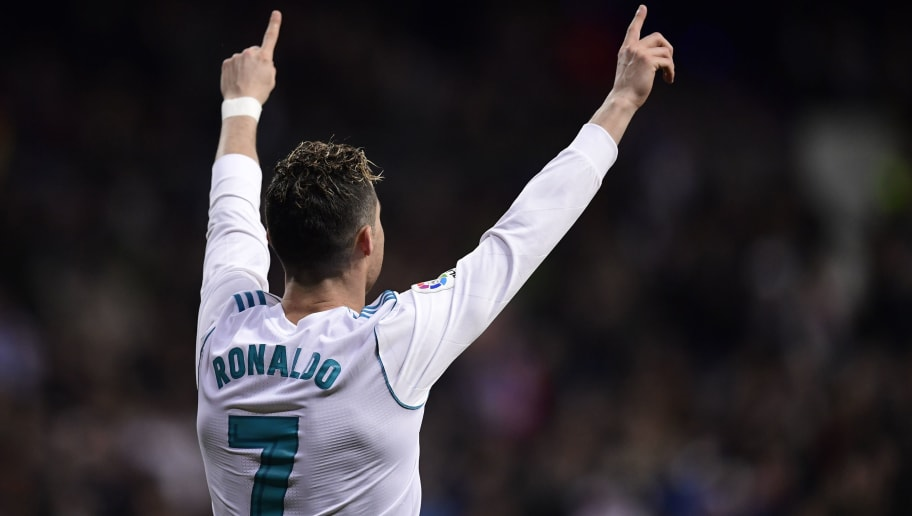 Real Madrid's Portuguese forward Cristiano Ronaldo celebrates a goal during the Spanish League football match between Real Madrid CF and Girona FC at the Santiago Bernabeu stadium in Madrid on March 18, 2018. / AFP PHOTO / JAVIER SORIANO        (Photo credit should read JAVIER SORIANO/AFP/Getty Images)