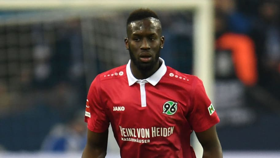 Hanover's Senegalese defender Salif Sane runs with the ball during the German First division Bundesliga football match FC Schalke 04 vs Hanover 96 in Gelsenkirchen, western Germany, on January 21, 2018. / AFP PHOTO / PATRIK STOLLARZ / RESTRICTIONS: DURING MATCH TIME: DFL RULES TO LIMIT THE ONLINE USAGE TO 15 PICTURES PER MATCH AND FORBID IMAGE SEQUENCES TO SIMULATE VIDEO. == RESTRICTED TO EDITORIAL USE == FOR FURTHER QUERIES PLEASE CONTACT DFL DIRECTLY AT + 49 69 650050         (Photo credit should read PATRIK STOLLARZ/AFP/Getty Images)