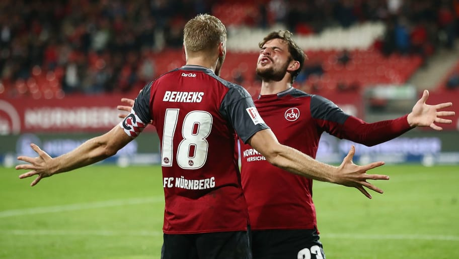 NUREMBERG, GERMANY - SEPTEMBER 21:  Hanno Behrens (front) of Nuernberg celebrates his team's second goal with team mate Tim Leibold during the Second Bundesliga match between 1. FC Nuernberg and VfL Bochum 1848 at Max-Morlock-Stadion on September 21, 2017 in Nuremberg, Germany.  (Photo by Alex Grimm/Bongarts/Getty Images)