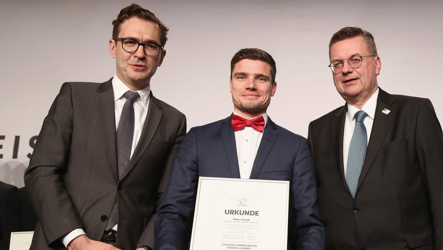 NEU ISENBURG, GERMANY - MARCH 19: Robert Klauss poses with DFB Secretary General Friedrich Curtius, DFB President Reinhard Grindel and Frank Wormuth after receiving his certificate during the Coaching Award Ceremony & Closing Event UEFA Pro Coaching Course 2017/2018 at Kempinski Hotel Frankfurt on March 19, 2018 in Neu Isenburg, Germany.  (Photo by Alex Grimm/Bongarts/Getty Images)