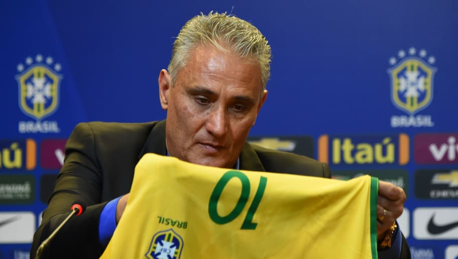 Adenor Leonardo Bacchi, known as Tite, holds a jersey of the Brazilian national football team during a press conference after being appointment by the Brazilian Football Confederation (CBF) as the new national team coach, in Rio de Janeiro, Brazil, on June 20, 2016. The news was first revealed by his former club Corinthians on Wednesday of last week. Tite succeeds Dunga, who was sacked following Brazil's dismal group stage elimination from the ongoing Copa America Cenetnario in the United States. Tite will take over after the Rio Olympics, where the Selecao will be coached by Micale, the current under-20s national team boss. / AFP / VANDERLEI ALMEIDA        (Photo credit should read VANDERLEI ALMEIDA/AFP/Getty Images)