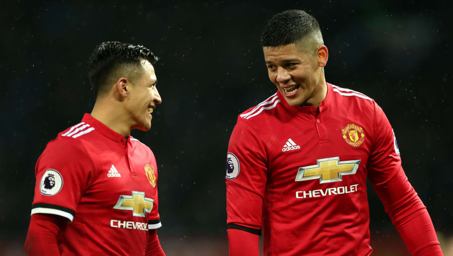 MANCHESTER, ENGLAND - FEBRUARY 03:  Alexis Sanchez of Manchester United and Marcos Rojo of Manchester United react after the Premier League match between Manchester United and Huddersfield Town at Old Trafford on February 3, 2018 in Manchester, England.  (Photo by Alex Morton/Getty Images)