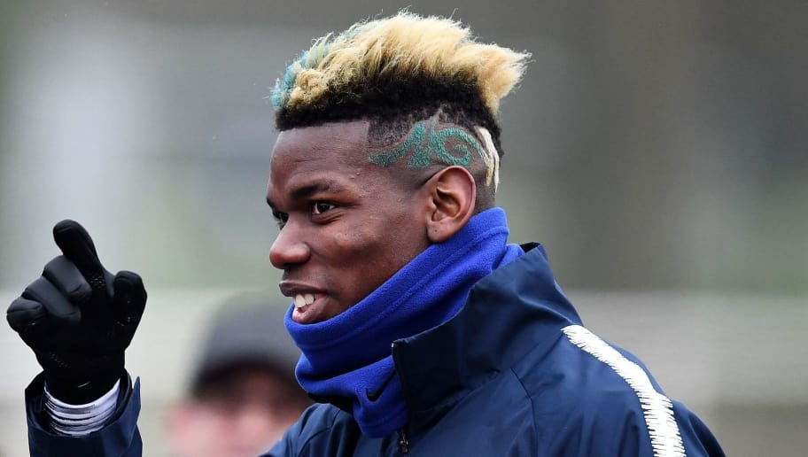 France's midfielder Paul Pogba gestures next to a fans before  a training session in Clairefontaine-en-Yvelines, southwest of Paris, on March 19, 2018, as part of the team's preparation for the friendly football matches against Colombia and Russia.   / AFP PHOTO / FRANCK FIFE        (Photo credit should read FRANCK FIFE/AFP/Getty Images)