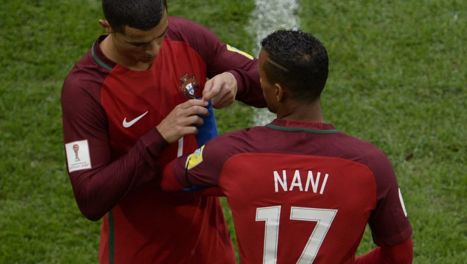 Portugal's forward Cristiano Ronaldo (L) gives his captain armband to Portugal's forward Nani as he leaves the pitch after being substituted during the 2017 Confederations Cup group A football match between New Zealand and Portugal at the Saint Petersburg Stadium in Saint Petersburg on June 24, 2017. / AFP PHOTO / Olga MALTSEVA        (Photo credit should read OLGA MALTSEVA/AFP/Getty Images)