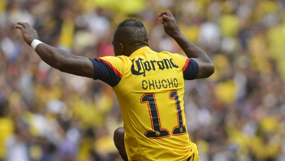 Christian Benitez of America celebrates the first goal against Pumas jumping a billboard during  their Mexican Clausura Tournament quarterfinal football match on May 11, 2013 at the Azteca stadium in Mexico city. AFP PHOTO/OMAR TORRES        (Photo credit should read OMAR TORRES/AFP/Getty Images)
