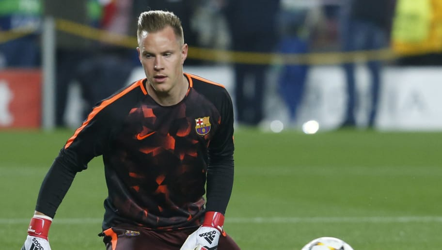 Barcelona's German goalkeeper Marc-Andre Ter Stegen warms up before the UEFA Champions League round of sixteen second leg  football match between FC Barcelona and Chelsea FC at the Camp Nou stadium in Barcelona on March 14, 2018. / AFP PHOTO / Pau Barrena        (Photo credit should read PAU BARRENA/AFP/Getty Images)