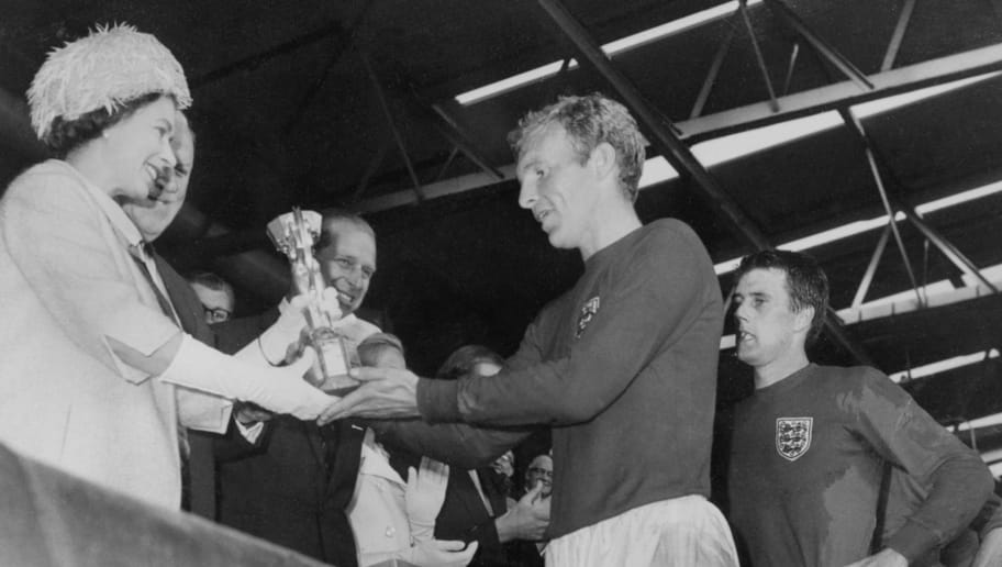 LONDON, UNITED KINGDOM - JULY 30:  Queen Elizabeth of England presents the Jules Rimet Cup to Bobby Moore, captain of England's national soccer team, as her husband Prince Philip (C) and forward Geoff Hurst (R) look on after England beat West Germany 4-2 in extra time in the World Cup final 30 July 1966 at Wembley stadium in London. Hurst scored three goals, two of them in extra time, to help England win its first World title. AFP PHOTO  (Photo credit should read STAFF/AFP/Getty Images)