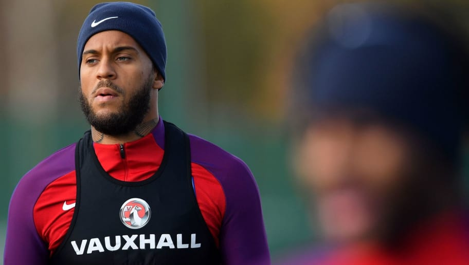 England's defender Ryan Bertrand (L) arrives to take part in an England national football team training session at Tottenham Hotspur FC Training Ground in Enfield, north London, on November 13, 2017 ahead of their international friendly match against Brazil on November 14.  / AFP PHOTO / Ben STANSALL / NOT FOR MARKETING OR ADVERTISING USE / RESTRICTED TO EDITORIAL USE         (Photo credit should read BEN STANSALL/AFP/Getty Images)