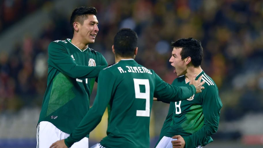Mexico's forward Hirving Lozano (R) celebrates with teammates  after scoring a goal during the international friendly football match between Belgium and Mexico at the King Baudouin Stadium in Brussels on November 10, 2017. / AFP PHOTO / JOHN THYS        (Photo credit should read JOHN THYS/AFP/Getty Images)