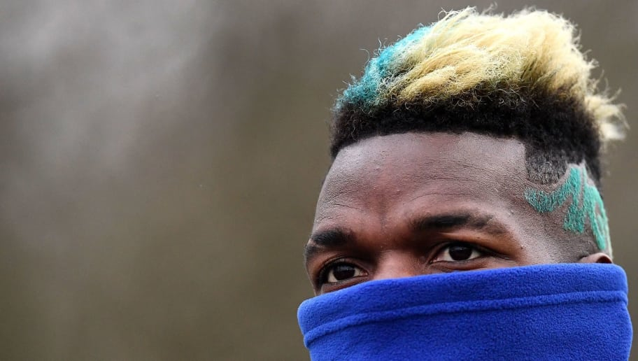 France's midfielder Paul Pogba reacts during a training session in Clairefontaine-en-Yvelines, southwest of Paris, on March 19, 2018, as part of the team's preparation for the friendly football matches against Colombia and Russia.   / AFP PHOTO / FRANCK FIFE        (Photo credit should read FRANCK FIFE/AFP/Getty Images)