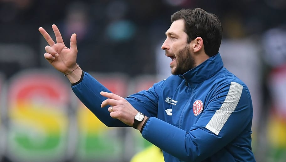FRANKFURT AM MAIN, GERMANY - MARCH 17: Sandro Schwarz, coach of Mainz, gestures during the Bundesliga match between Eintracht Frankfurt and 1. FSV Mainz 05 at Commerzbank-Arena on March 17, 2018 in Frankfurt am Main, Germany. (Photo by Matthias Hangst/Bongarts/Getty Images)