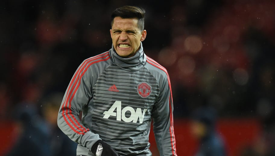 Manchester United's Chilean striker Alexis Sanchez warms up before the English FA Cup quarter-final football match between Manchester United and Brighton and Hove Albion at Old Trafford in Manchester, north west England, on March 17, 2018. / AFP PHOTO / Oli SCARFF / RESTRICTED TO EDITORIAL USE. No use with unauthorized audio, video, data, fixture lists, club/league logos or 'live' services. Online in-match use limited to 75 images, no video emulation. No use in betting, games or single club/league/player publications.  /         (Photo credit should read OLI SCARFF/AFP/Getty Images)
