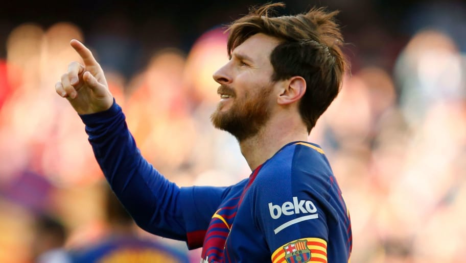 TOPSHOT - Barcelona's Argentinian forward Lionel Messi celebrates after scoring during the Spanish League football match between FC Barcelona and Athletic Club Bilbao at the Camp Nou stadium in Barcelona on March 18, 2018. / AFP PHOTO / Pau Barrena        (Photo credit should read PAU BARRENA/AFP/Getty Images)