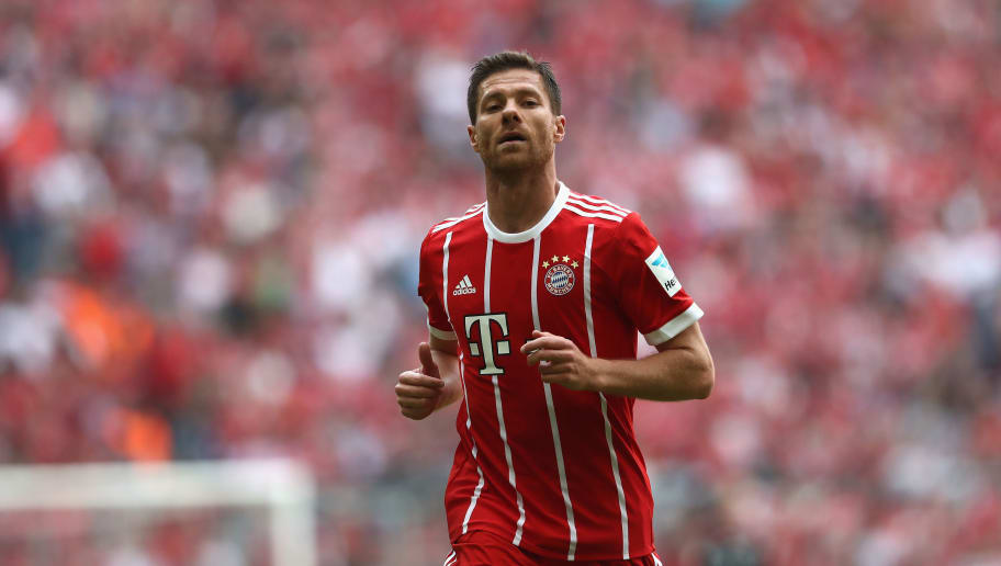 MUNICH, GERMANY - MAY 20:  Xabi Alonso of Bayern Muenchen looks on uring the Bundesliga match between Bayern Muenchen and SC Freiburg at Allianz Arena on May 20, 2017 in Munich, Germany.  (Photo by Alexander Hassenstein/Bongarts/Getty Images)