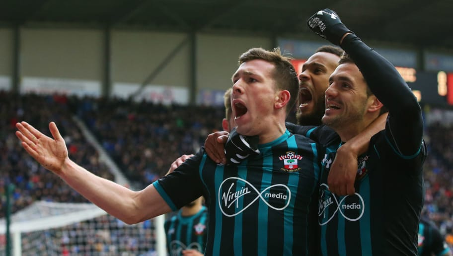WIGAN, ENGLAND - MARCH 18:  Pierre-Emile Hojbjerg of Southampton (L) celebrates as he scores their first goal with Dusan Tadic and Ryan Bertrand during The Emirates FA Cup Quarter Final match between Wigan Athletic and Southampton at DW Stadium on March 18, 2018 in Wigan, England.  (Photo by Alex Livesey/Getty Images)