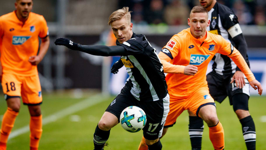 MOENCHENGLADBACH, GERMANY - MARCH 17: Oscar Wendt of Moenchengladbach is challenged by Pavel Kaderabek of Hoffenheim during the Bundesliga match between Borussia Moenchengladbach and TSG 1899 Hoffenheim at Borussia-Park on March 17, 2018 in Moenchengladbach, Germany.  (Photo by Lars Baron/Bongarts/Getty Images)