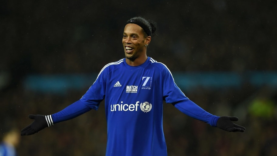 Rest of the World's Brazilian striker Ronaldinho gestures during a charity football match between a Great Britain and Ireland team and a Rest of the World team at Old Trafford in Manchester, north west England November 14, 2015 in aid of UNICEF. AFP PHOTO / PAUL ELLIS        (Photo credit should read PAUL ELLIS/AFP/Getty Images)