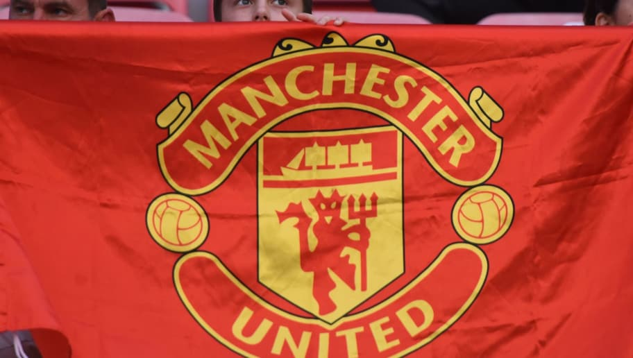 A boy displays a Manchester United flag prior to the UEFA Super Cup football match between Real Madrid and Manchester United on August 8, 2017, at the Philip II Arena in Skopje. / AFP PHOTO / ARMEND NIMANI        (Photo credit should read ARMEND NIMANI/AFP/Getty Images)
