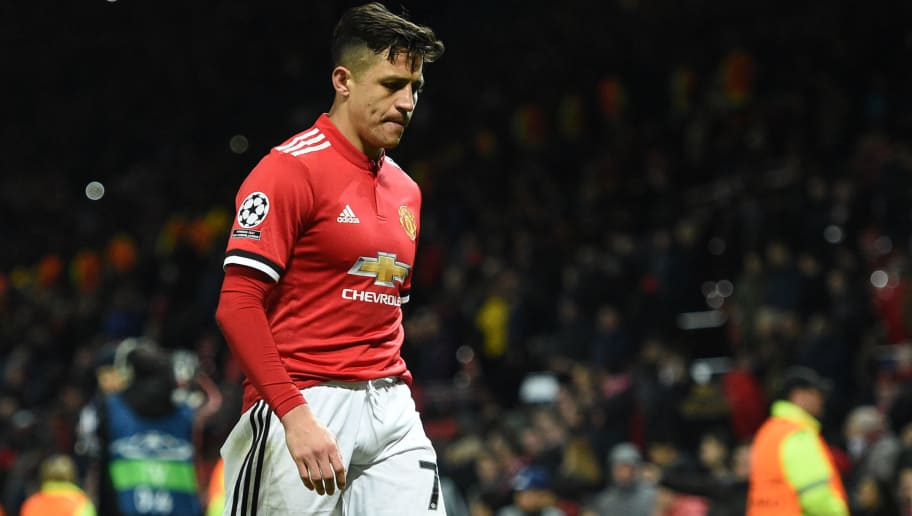 Manchester United's Chilean striker Alexis Sanchez leaves the pitch after losing a last 16 second leg UEFA Champions League football match between Manchester United and Sevilla at Old Trafford in Manchester, northwest England on March 13, 2018. / AFP PHOTO / Oli SCARFF        (Photo credit should read OLI SCARFF/AFP/Getty Images)