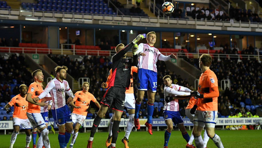 READING, ENGLAND - JANUARY 16:  Ben Wilmot of Stevenage jumps with Anssi Jaakkola of Reading during The Emirates FA Cup Third Round Replay match between Reading and Stevenage at Madejski Stadium on January 16, 2018 in Reading, England.  (Photo by Mike Hewitt/Getty Images)
