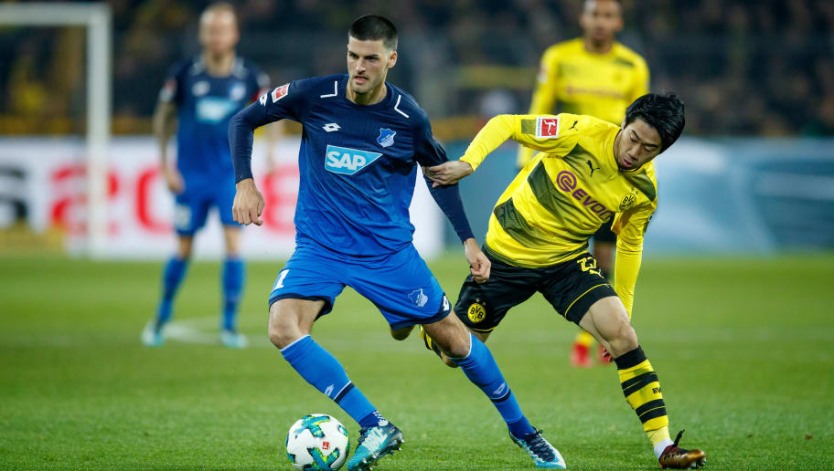 DORTMUND, GERMANY - DECEMBER 16:  Florian Grillitsch of Hoffenheim is challenged by Shinji Kagawa of Dortmund during the Bundesliga match between Borussia Dortmund and TSG 1899 Hoffenheim at Signal Iduna Park on December 16, 2017 in Dortmund, Germany.  (Photo by Lars Baron/Bongarts/Getty Images)