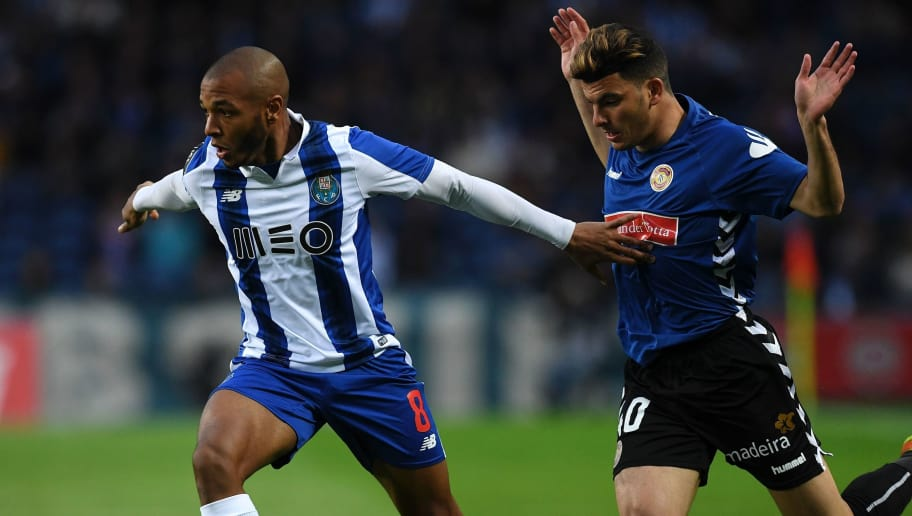 Porto's Algerian midfielder Yacine Brahimi (L) vies with Nacional's Egyptian midfielder Zizo during the Portuguese league football match FC Porto vs CD Nacional Funchal at the Dragao stadium in Porto on March 4, 2017. / AFP PHOTO / FRANCISCO LEONG        (Photo credit should read FRANCISCO LEONG/AFP/Getty Images)