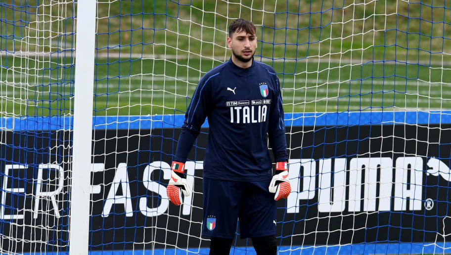 FLORENCE, ITALY - MARCH 20:  Gianluigi Donnarumma of Italy looks on during a training session at Centro Tecnico Federale di Coverciano on March 20, 2018 in Florence, Italy.  (Photo by Claudio Villa/Getty Images)