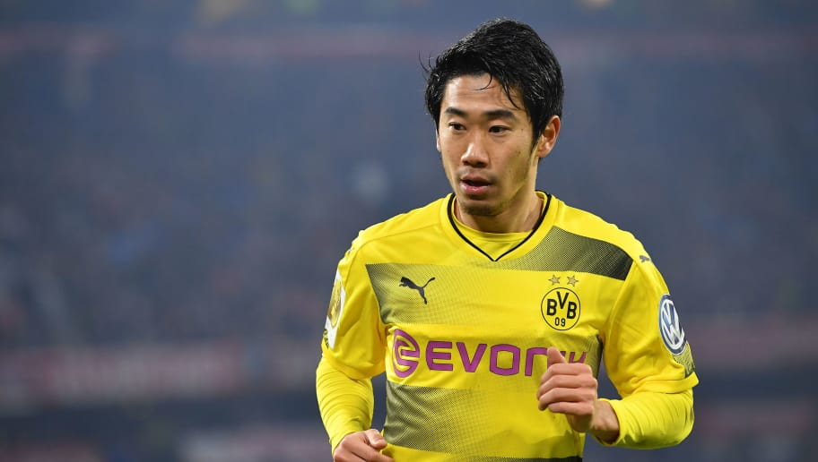 MUNICH, GERMANY - DECEMBER 20: Shinji Kagawa of Dortmund looks on during the DFB Cup match between Bayern Muenchen and Borussia Dortmund at Allianz Arena on December 20, 2017 in Munich, Germany. (Photo by Sebastian Widmann/Bongarts/Getty Images)