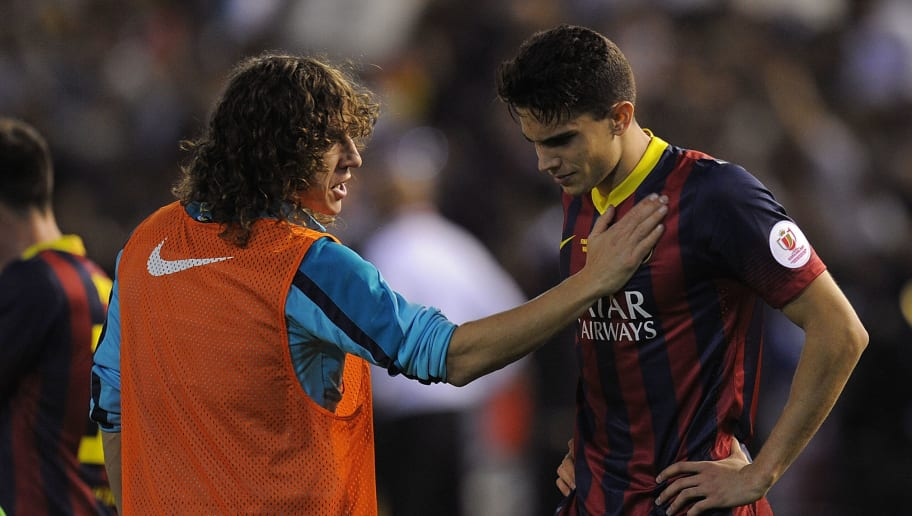VALENCIA, SPAIN - APRIL 16:  Marc Bartra (R) of FC Barcelona is consoled by teammate Carles Puyol after losing 2-1 to Real Madrid in the Copa del Rey Final between Real Madrid and Barcelona at Estadio Mestalla on April 16, 2014 in Valencia, Spain.  (Photo by Denis Doyle/Getty Images)