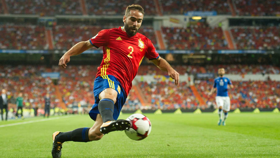 MADRID, SPAIN - SEPTEMBER 02: Dani Carvajal of Spain crosses the ball during the FIFA 2018 World Cup Qualifier between Spain and Italy at Estadio Santiago Bernabeu on September 2, 2017 in Madrid, . (Photo by Denis Doyle/Getty Images)