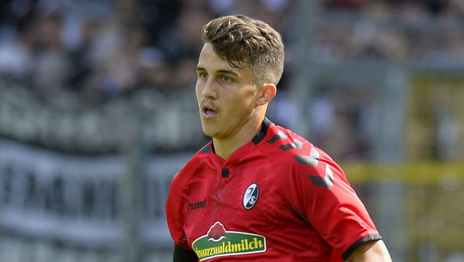 Freiburg's defender Marc-Oliver Kempf controls the ball during the German First division Bundesliga football match SC Freiburg v Eintracht Frankfurt in Freiburg, southern Germany on August 20, 2017. / AFP PHOTO / THOMAS KIENZLE / RESTRICTIONS: DURING MATCH TIME: DFL RULES TO LIMIT THE ONLINE USAGE TO 15 PICTURES PER MATCH AND FORBID IMAGE SEQUENCES TO SIMULATE VIDEO. == RESTRICTED TO EDITORIAL USE == FOR FURTHER QUERIES PLEASE CONTACT DFL DIRECTLY AT + 49 69 650050         (Photo credit should read THOMAS KIENZLE/AFP/Getty Images)