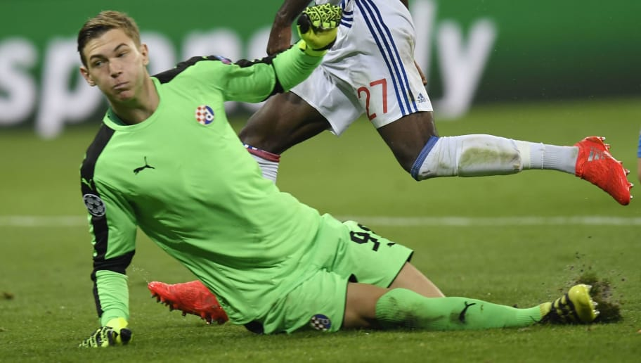 Lyon's French forward Maxwel Cornet (C) reacts after scoring past Dinamo Zagreb's Croatian goalkeeper Adrian Semper (L) during the Champions League Group H football match between Olympique Lyonnais and Dinamo Zagreb at the Parc Olympique Lyonnais in Decines-Charpieu on September 14, 2016.  / AFP / PHILIPPE DESMAZES        (Photo credit should read PHILIPPE DESMAZES/AFP/Getty Images)