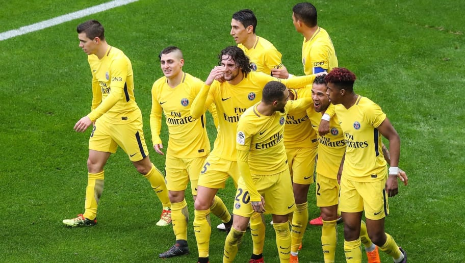(From L) Paris Saint-Germain's Argentinian midfielder Giovanni Lo Celso, Paris Saint-Germain's Italian midfielder Marco Verratti, Paris Saint-Germain's French midfielder Adrien Rabiot, Paris Saint-Germain's Argentinian forward Angel Di Maria (Rear), Paris Saint-Germain's French defender Layvin Kurzawa (Front), Paris Saint-Germain's French defender Presnel Kimpembe (R) congratulate Paris Saint-Germain's Brazilian defender Daniel Alves (2ndR) after he scored the winning goal during the French L1 football match Nice (OGCN) vs Paris Saint-Germain (PSG) on March 18, 2018 at the Allianz Riviera stadium in Nice.  / AFP PHOTO / Valery HACHE        (Photo credit should read VALERY HACHE/AFP/Getty Images)