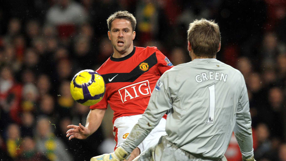 Manchester United's English forward Michael Owen (L) scores the third goal past West Ham United's English goalkeeper Robert Green during the English Premier League football match at Old Trafford in Manchester, north-west England on February 23, 2010. AFP PHOTO/ANDREW YATES --- RESTRICTED TO EDITORIAL USE Additional licence required for any commercial/promotional use or use on TV or internet (except identical online version of newspaper) of Premier League/Football League photos. Tel DataCo +44 207 2981656. Do not alter/modify photo (Photo credit should read ANDREW YATES/AFP/Getty Images)