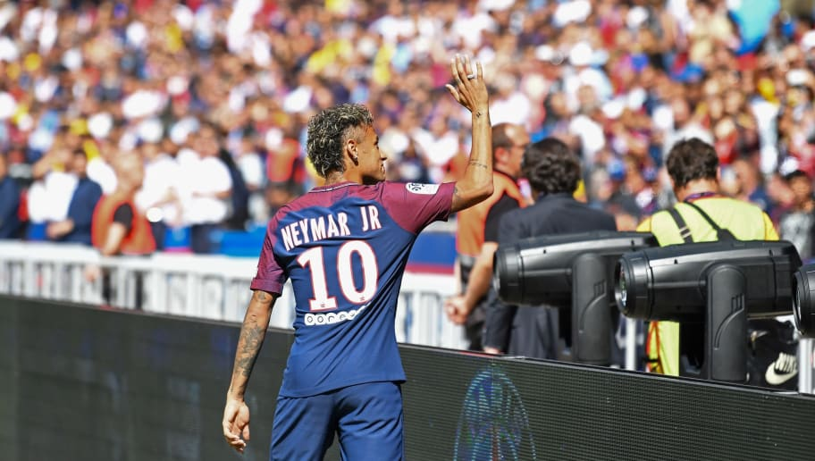 Paris Saint-Germain's Brazilian forward Neymar waves to the crowd during his presentation to the fans at the Parc des Princes stadium in Paris on August 5, 2017. Brazil superstar Neymar will watch from the stands as Paris Saint-Germain open their season on August 5, 2017, but the French club have already clawed back around a million euros on their world record investment. Neymar, who signed from Barcelona for a mind-boggling 222 million euros ($264 million), is presented to the PSG support prior to his new team's first game of the Ligue 1 campaign against promoted Amiens.  / AFP PHOTO / ALAIN JOCARD        (Photo credit should read ALAIN JOCARD/AFP/Getty Images)