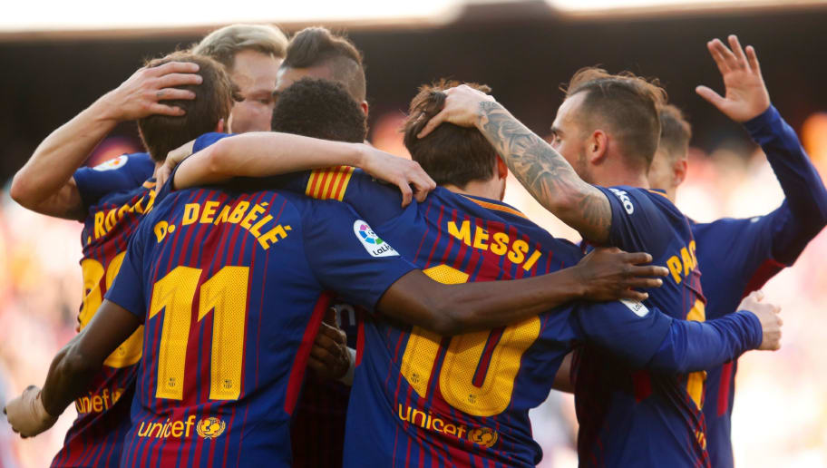 Barcelona's Argentinian forward Lionel Messi (C) celebrates with teammates after scoring during the Spanish League football match between FC Barcelona and Athletic Club Bilbao at the Camp Nou stadium in Barcelona on March 18, 2018. / AFP PHOTO / Pau Barrena        (Photo credit should read PAU BARRENA/AFP/Getty Images)