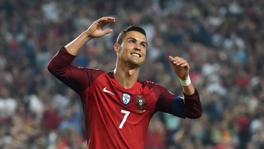 Portugal's forward Cristiano Ronaldo gestures during the WC2018 group B qualifying football match Portugal vs Switzerland at the Luz stadium in Lisbon on October 10, 2017. / AFP PHOTO / FRANCISCO LEONG        (Photo credit should read FRANCISCO LEONG/AFP/Getty Images)