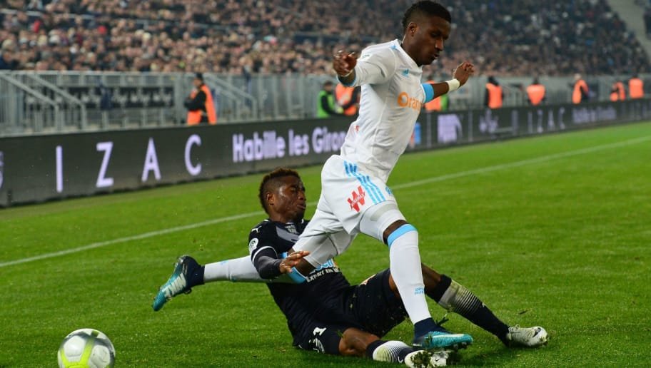 Bordeaux's Guinean forward Francois Kamano (L) fights for the ball with Olympique de Marseille's French forward Bouna Sarr (R) during the French Ligue 1 football match between Bordeaux and Marseille at The Matmut Atlantique Stadium in Bordeaux, southwestern France on November 19, 2017.  / AFP PHOTO / NICOLAS TUCAT        (Photo credit should read NICOLAS TUCAT/AFP/Getty Images)