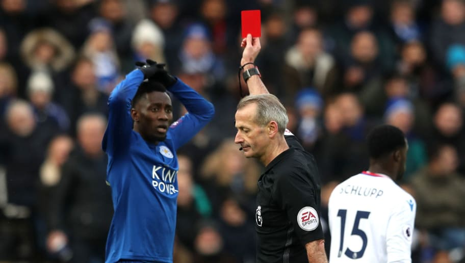 LEICESTER, ENGLAND - DECEMBER 16: Wilfred Ndidi of Leicester City is shown a red card by referee Martin Atkinson during the Premier League match between Leicester City and Crystal Palace at The King Power Stadium on December 16, 2017 in Leicester, England.  (Photo by Matthew Lewis/Getty Images)