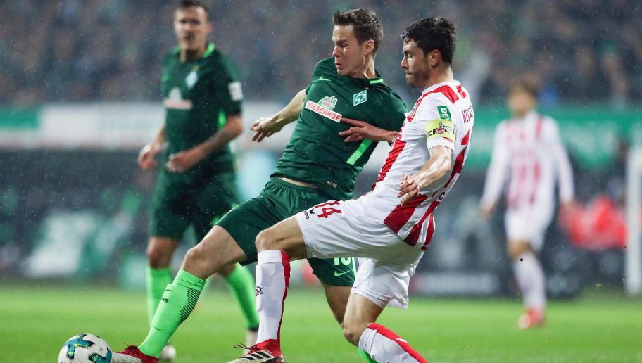 BREMEN, GERMANY - MARCH 12: Jonas Hector (R) of Koeln is challenged by Niklas Moisander of Bremen  during the Bundesliga match between SV Werder Bremen and 1. FC Koeln at Weserstadion on March 12, 2018 in Bremen, Germany.  (Photo by Lars Baron/Bongarts/Getty Images)