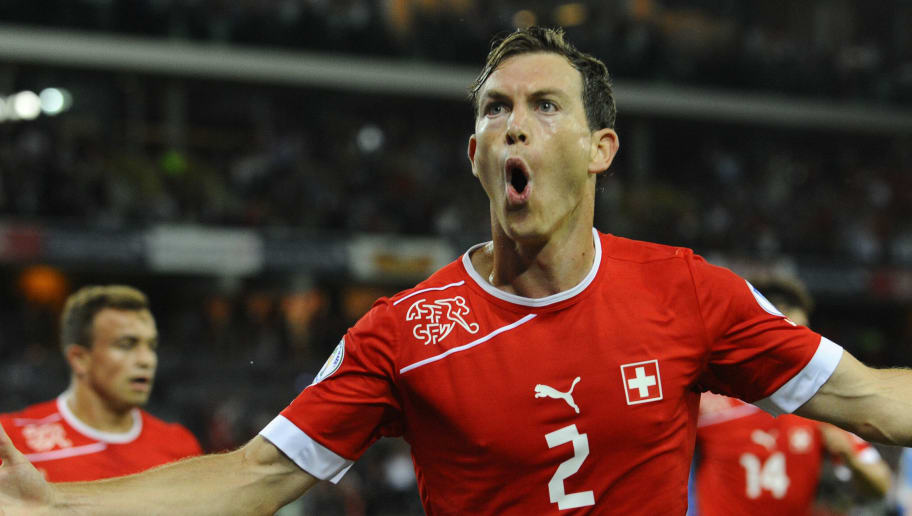 Switzerland's Stephan Lichtsteiner celebrates after scoring during a FIFA World Cup 2014 qualifying football match Switzerland vs Iceland at the Stade de Suisse on September 6, 2013 in Bern. AFP PHOTO / ALAIN GROSCLAUDE        (Photo credit should read ALAIN GROSCLAUDE/AFP/Getty Images)